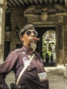 Cuba,Cigar-smoking official, old Havana, historical district. Havana