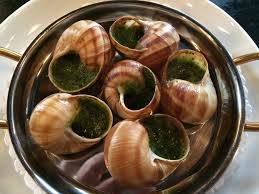 Paris, Escargot swimming in butter and garlic and dusted all over with chopped parsley