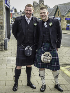 In Pitlochry, manly Scots in full Scottish Highland dress