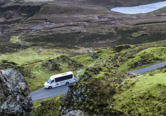 Rabbie's sleek 16-passenger van tours the Scottish Highlands