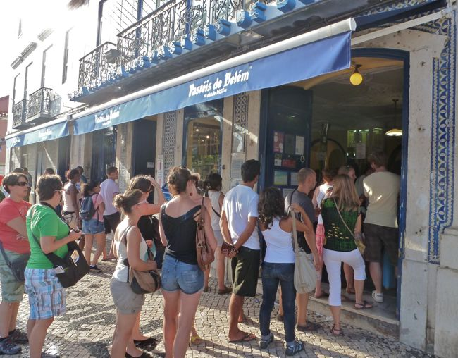 Crowds line up outside Pastéis de Belém, Portugal's most famous pastry tart, a love affair treat, Lisbon, Portugal