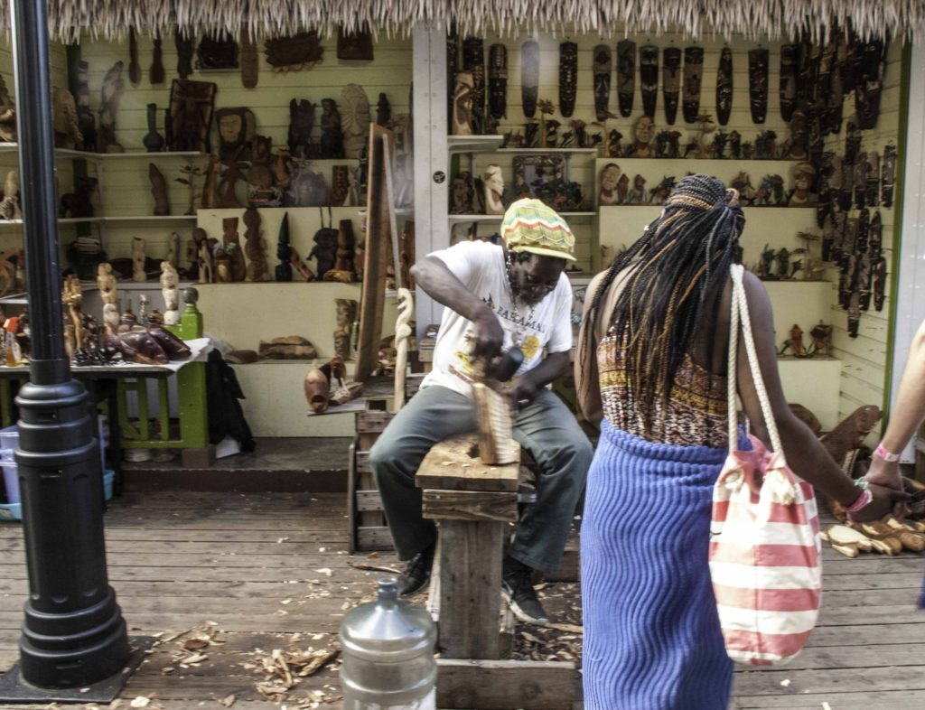 Rasta carver in the straw market of Nassau viewed during a shore excursion from Holland America Lines ms Nieuw Amsterdam