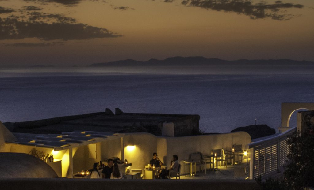 """Sunset dining at Oia; Georgós Nu Greek wine labeled """"Santorini"""" captures the spirit and character of wines from Santorini, Greece"""