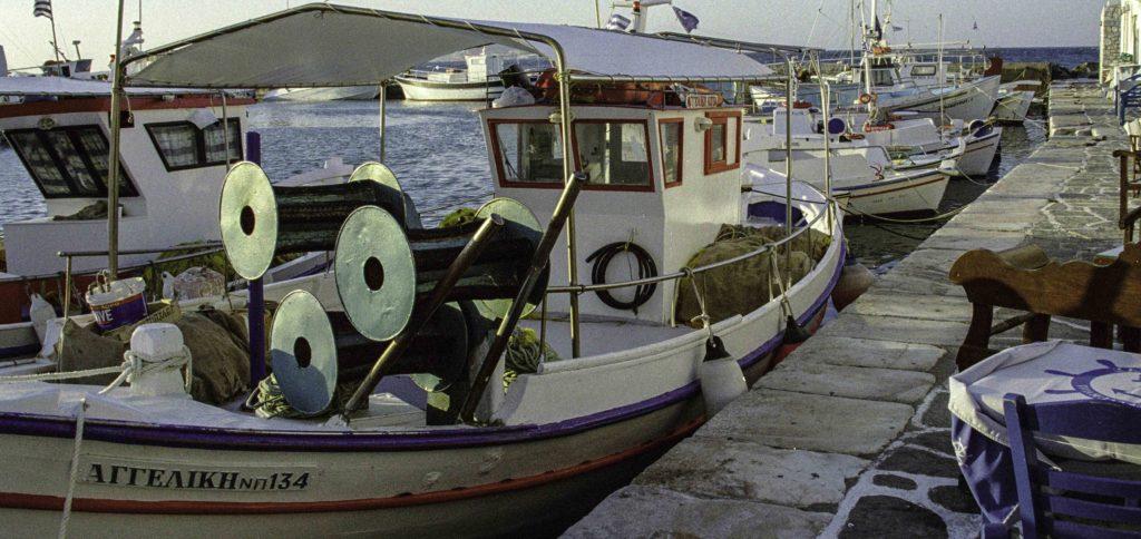 Quay-side dining in Naoussa harbor, Plastira Bay, Paros