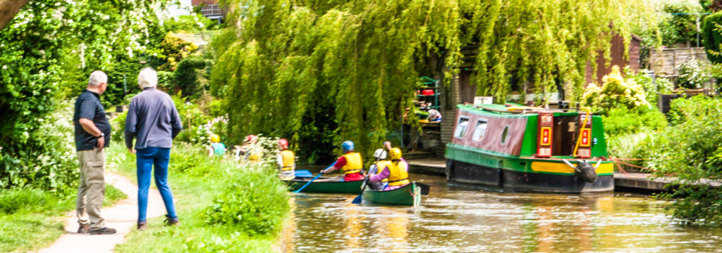 Canoeing on the Macclesfield Canal, Cheshire Ring Canals, Cheshire, UK