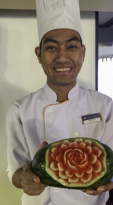 Chef Sopheap with his beautiful watermellon flower creation aboard AmaWaterways new ship AmaDara on a Mekong River cruise from Vietnam to Cambodia