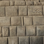Fine Inca stonework and snake marking suggest a former royal residence in Cusco, Peru