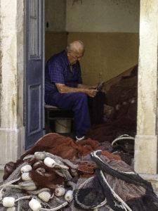 Fisherman tending his nets, Hvar Island, the Adriatic jewel ofCroatia's Dalmatian coast