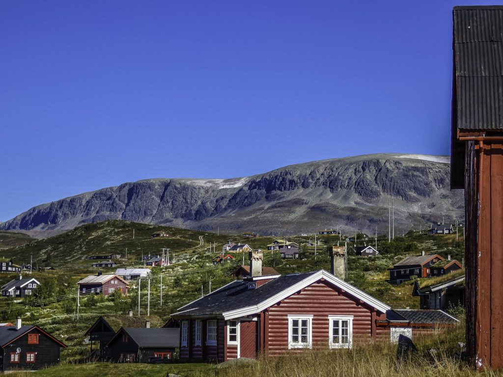 The settlement of Ustaoset with the flat-top mountains of Hallingskarvet National Park in the background,Oslo to Bergen by Train, Norway by Train