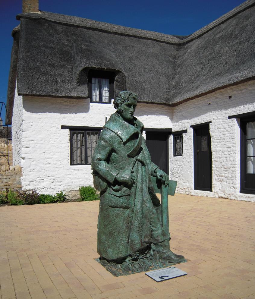 Clare statue in courtyard of Helpston cottage