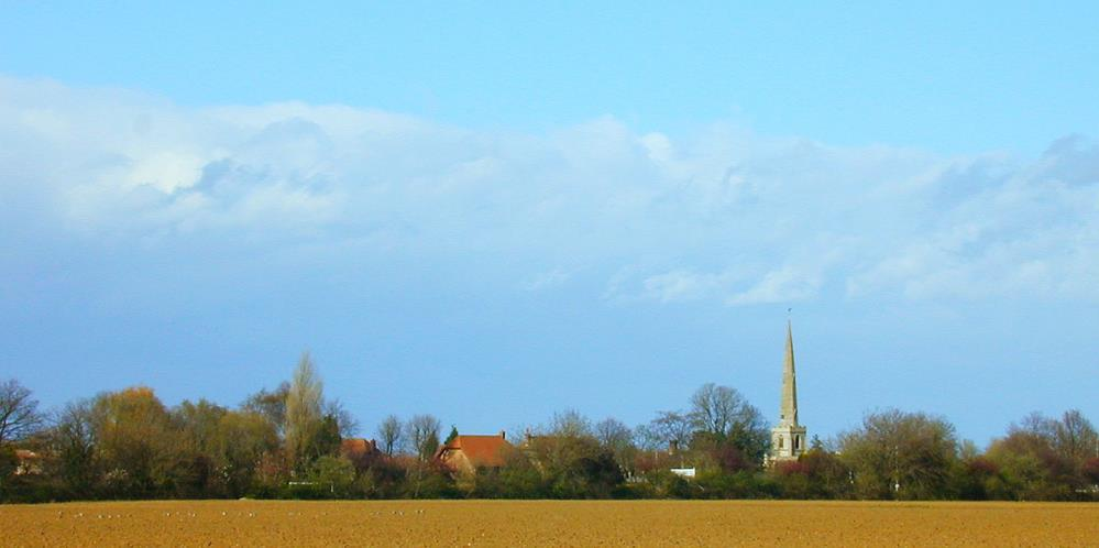Clinton Church spire towers over the flat fenland fields