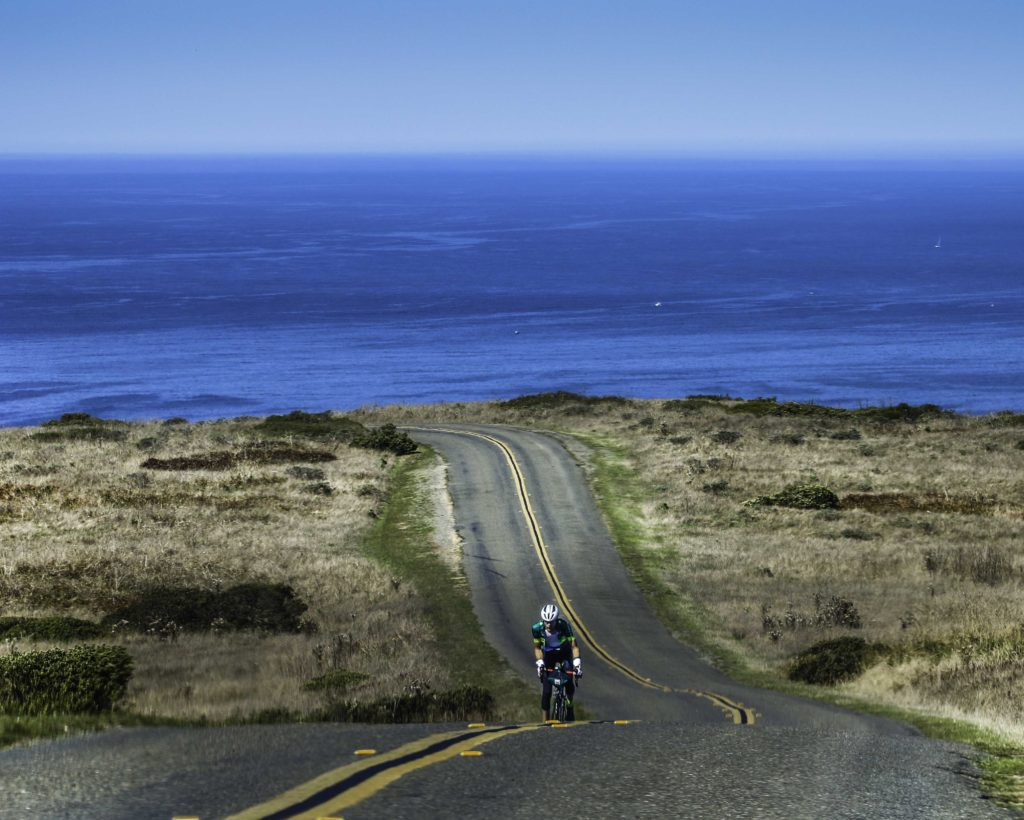 Cyclist on Pierce Point Road, Pierce Point Ranch, Point Reyes National Seashore, San Francisco Bay Area, Marin County, Northern California, California