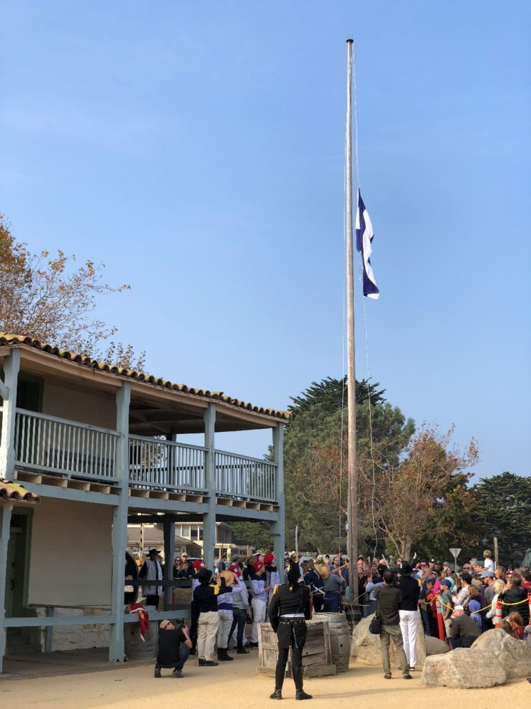 Bouchard salutes as the flag of Argentina is raised over the Custom House, Monterey, California