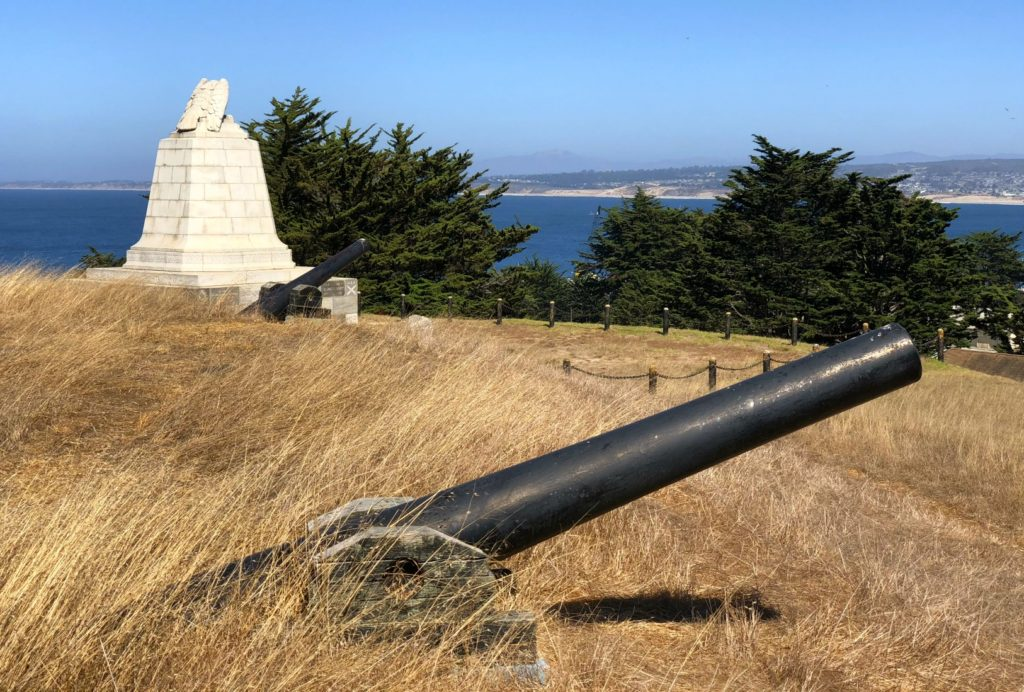 Cannons of Fort Mervine and the Sloat Monument overlook the bay, Monterey, California