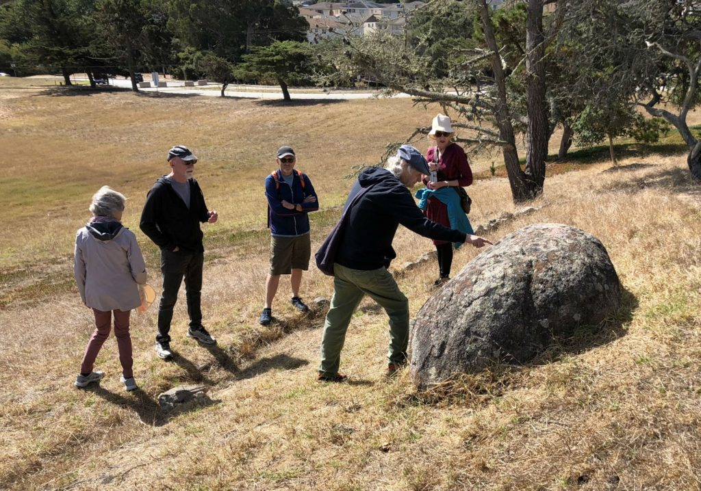 Historian Tim Thomas points to the Rain Rock, Monterey, California