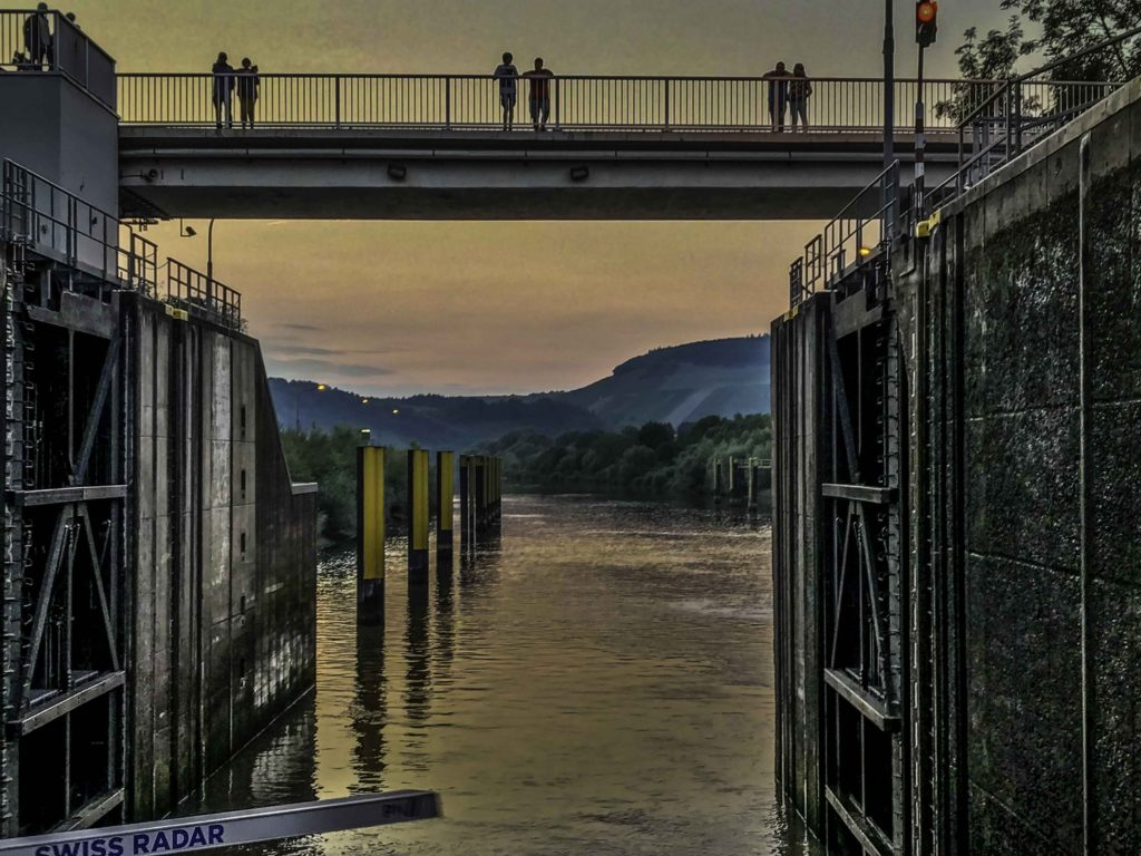 Ama Prima passing through a lock on the Mosel River at sunset, AmaWaterways cruise, Mosel river, Germany