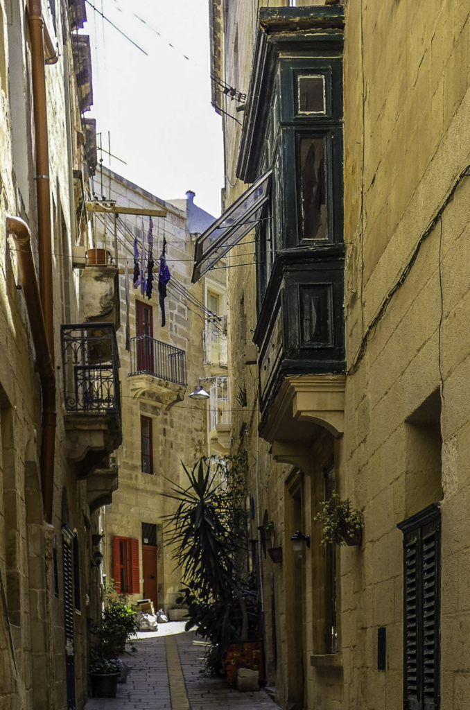 The labyrinth of narrow streets in Birgu, the former capital, contrasts with the perfect grid plan of the newer Valletta, Malta