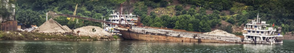 Sand and gravel hauler being unloaded on the Yangtze River, Chongqing, China, Three Gorges Cruise