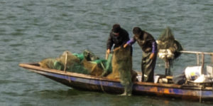 Fishermen check their nets, Yangtze River, China