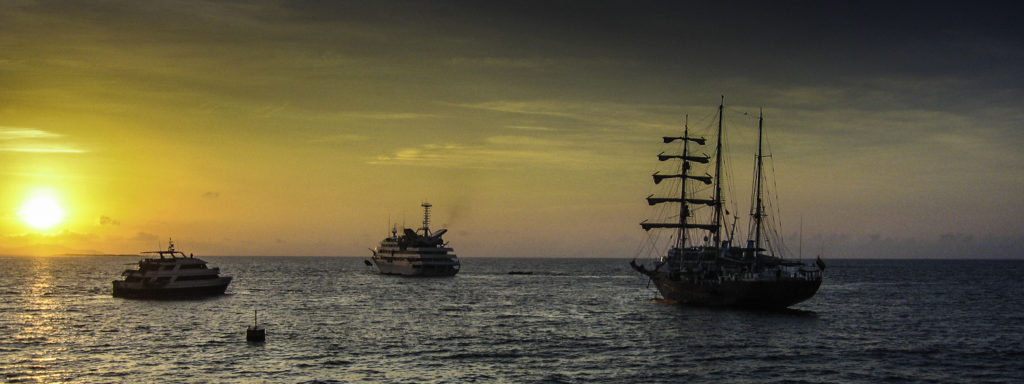 3 vessels at dusk in the Galapagos Islands, Ecuador