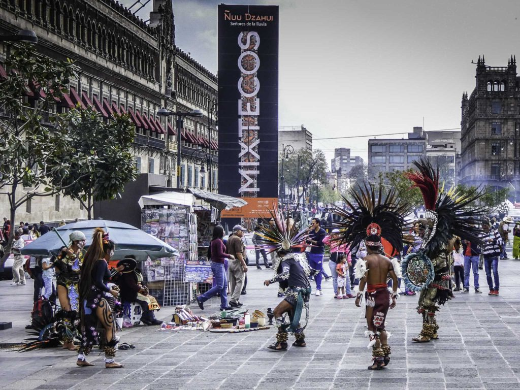 Zócalo, the main square of Mexico City. The poster highlights an exhibition about Mixtecos, the native group from which Cleo came in the movie Roma, Zocolo, Mexico City, Mexico.