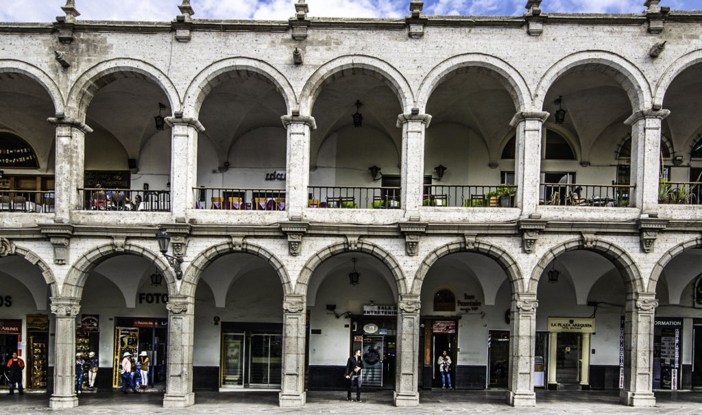 Arches with shops and cafes on the Plaza, Arequipa, Peru