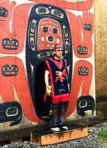Greeter in Eagle clan robe at Chief Shakes House, Wrangell, Alaska