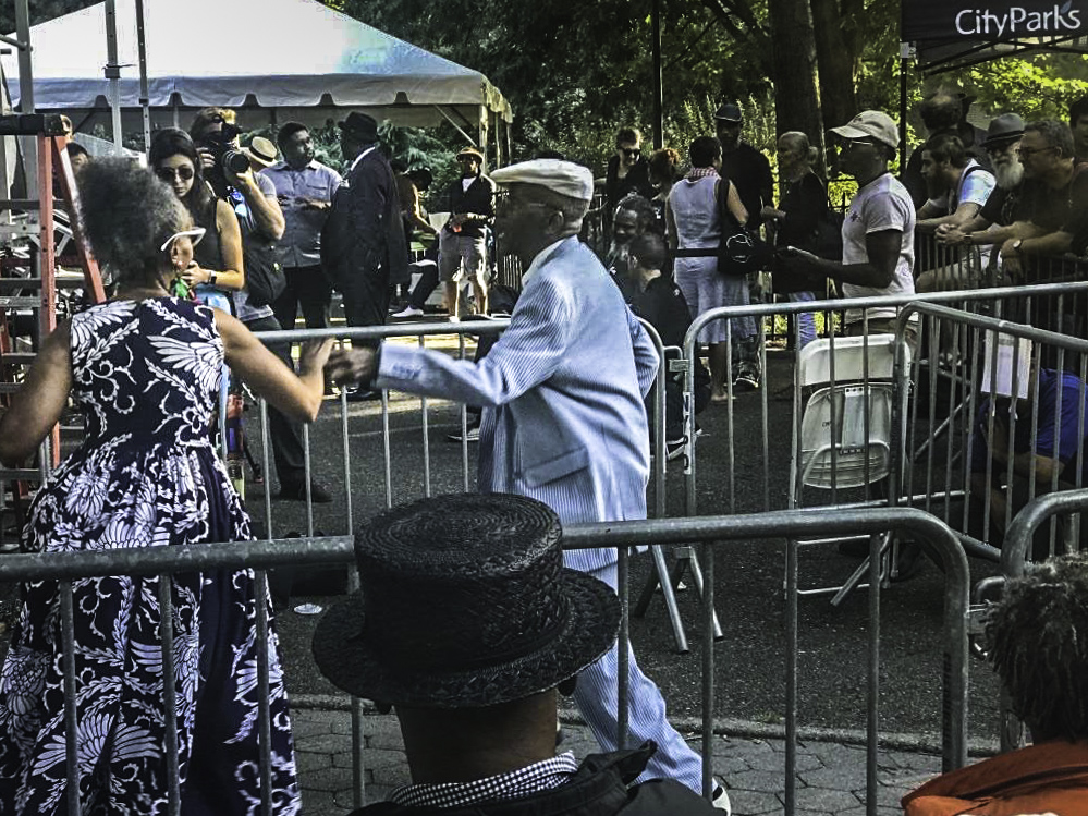 """Cutting the rug"" in Tomkins Square Park, New York City"