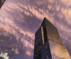 Futuristic asymmetrical skyscrapers at sunset, New York City