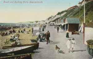Beach and bathing huts. Postcard circa 1920